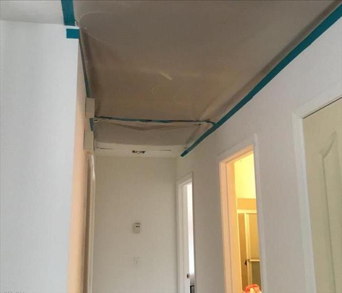 Storm damage causes leaks in a ceiling