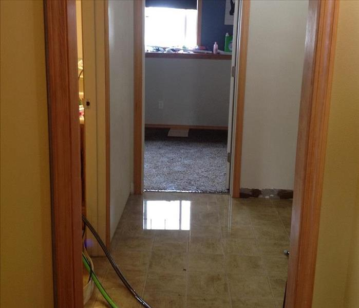 Wet floor, wet carpet, water damage in an office in Prescott Valley, AZ
