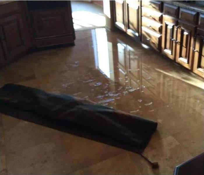 Standing water on kitchen floor, water damage in Prescott Valley, AZ